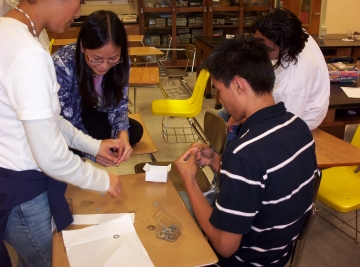 Uploaded Image: NSBE after school building paper bridges at Tri-Cities 2004.jpg